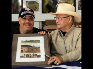 """Ron Turcotte jockey of Secretariat signs a picture of Big Red for Pick 6 King Jonathan Stettin"